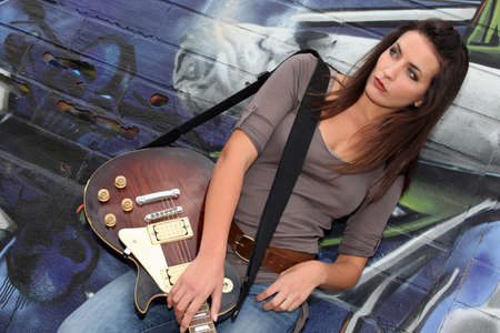 straps: Rebellious woman busking on the streets