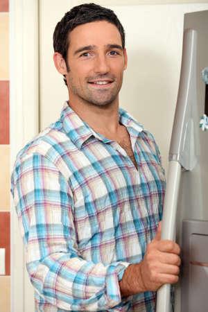 Man opening fridge photo
