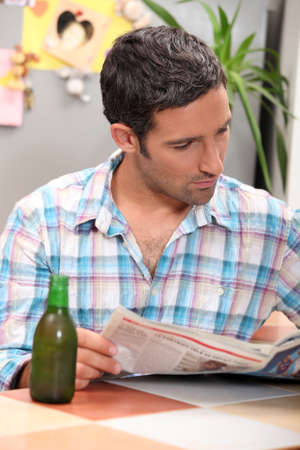 40 45: Man reading newspaper Stock Photo