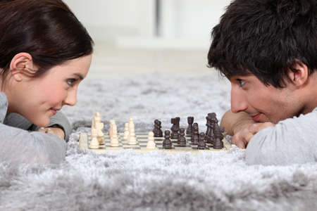 Man and woman playing chess photo