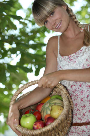 plait: Woman holding basket of fruit
