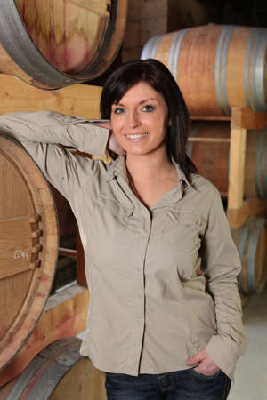 wine grower: a woman in a cellar Stock Photo