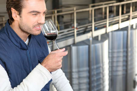 Man smelling his own wine photo
