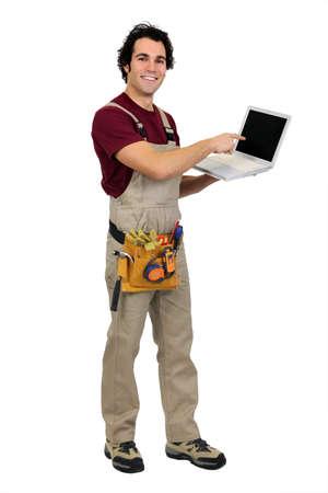 Carpenter pointing to laptop Stock Photo - 11136126