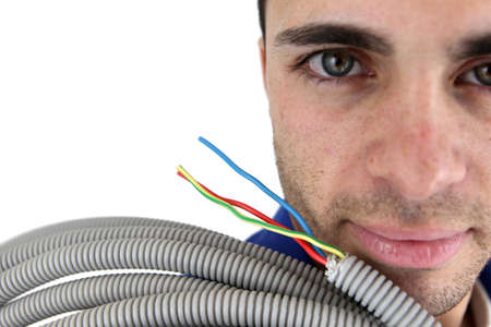 conduit: Electrician with conduit Stock Photo