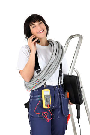 trainees: Female electrician making telephone call Stock Photo