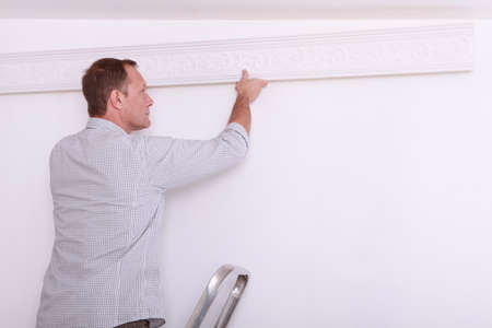 solidify: man installing a protection on a wall