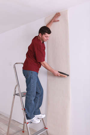 substitution: man upholstering a wall