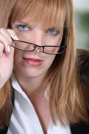 Redhead woman in glasses photo