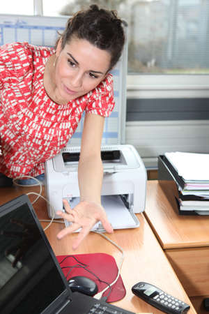 diverted: Young woman leaning on a desk