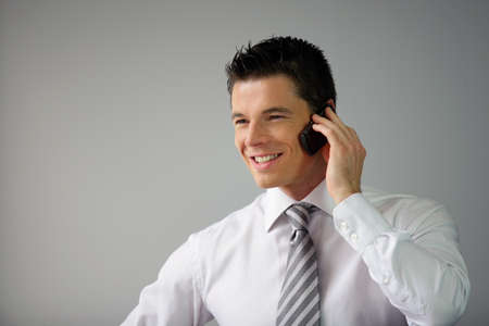 Happy executive on the phone Stock Photo - 11136037