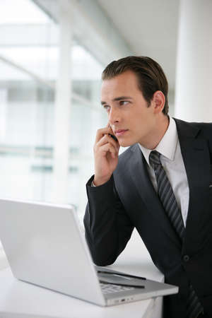 Confident businessman on phone Stock Photo - 11136137