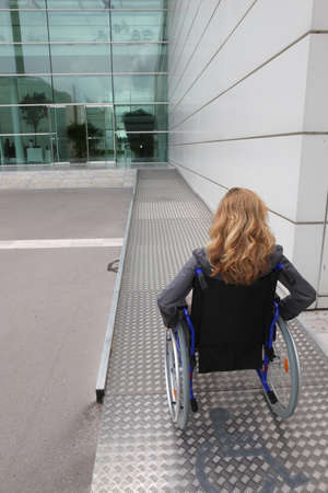 on ramp: woman in a wheelchair