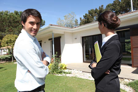real estate investment: Estate-agent outside property Stock Photo