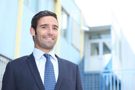 executive affable: Smiling businessman outside a building Stock Photo