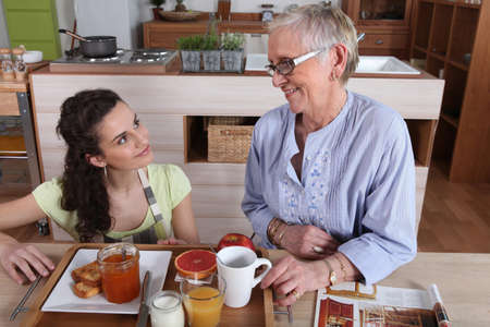 apricot jam: Mother and daughter in kitchen