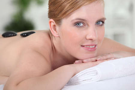 young woman relaxing on the massage table Stock Photo - 11135785