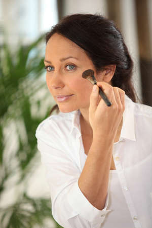 Woman with make-up brush photo