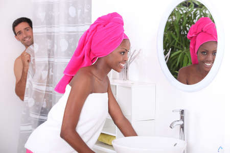 black man white woman: portrait of a young woman in bathroom
