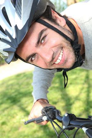 bicycling: Young man having a bike ride
