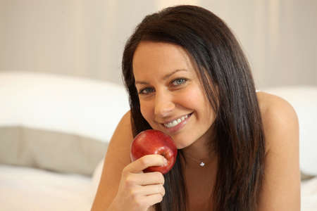Woman eating an apple Stock Photo - 11135932