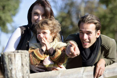 Family leaning against wooden fence Stock Photo - 11136024