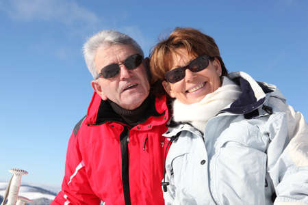 Mature couple on a skiing holiday photo