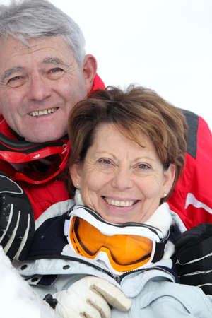 Elderly couple skiing Stock Photo - 11136033