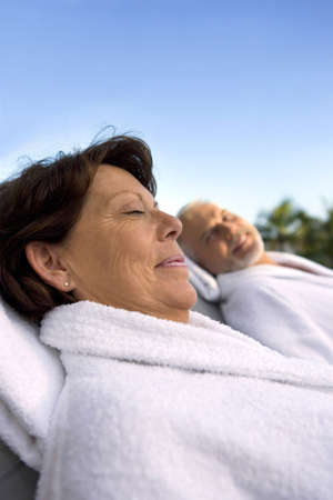 bath gown: Couple laying in dressing gowns