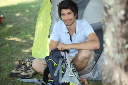 Man sitting in front of his tent Stock Photo - 11135843