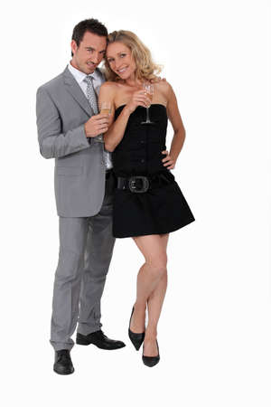 lbd: Man and woman in party clothes drinking champagne Stock Photo