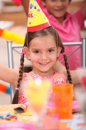 kiddie: Young girl at a birthday party Stock Photo
