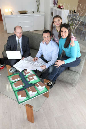 Family with estate agent photo