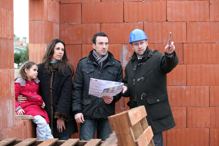 inspecting: Couple having their new home inspected by an engineer