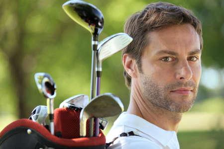 18 30s: Man carrying golf bag