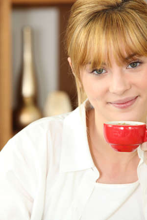Young woman drinking a cup of expresso coffee photo