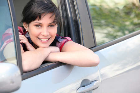Woman leaning on the window of her car photo
