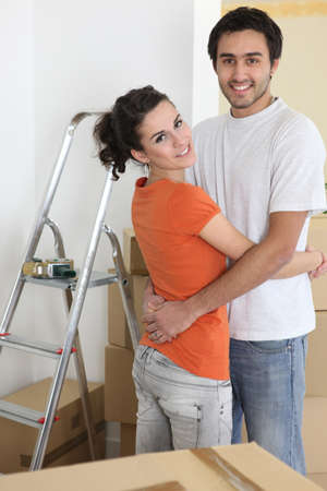 Couple hugging by ladder photo