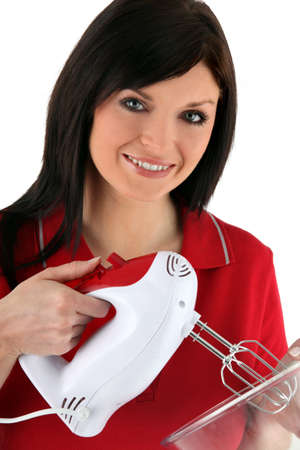 hiebe: Hausfrau mit einem Mischer