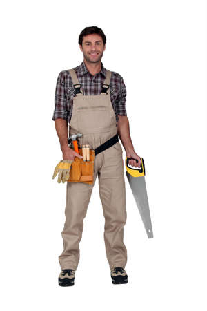 Builder smiling with saw. photo