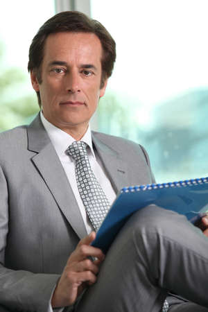 Businessman with notepad Stock Photo - 11135904
