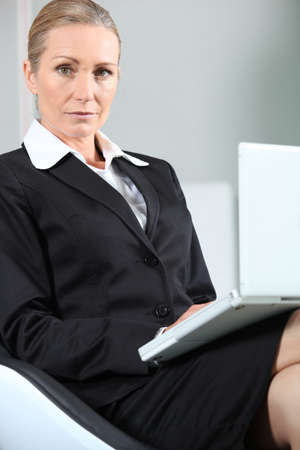 Unhappy businesswoman with laptop. Stock Photo - 11135968