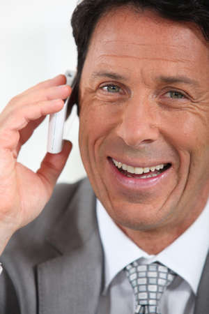 45 55 years: Businessman on the phone smiling Stock Photo