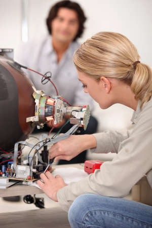 Woman repairing television Stock Photo - 11136020