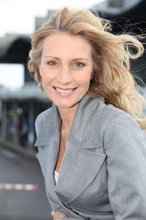 woman 40 years: Businesswoman smiling with wind in hair