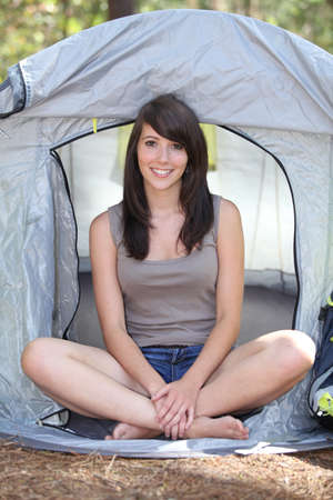 Teenage girl sat in tent photo