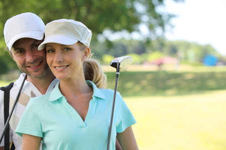 golf cap: Golfer couple Stock Photo