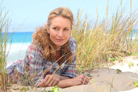 40 50: Woman laying on the sand