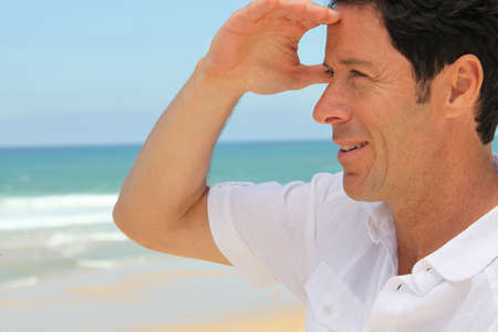 man 40 50: Man looking out to sea.