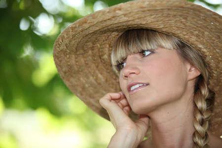 straw hat: Woman wearing straw hat